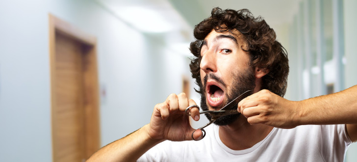 bigstock-Man-Cutting-Beard-indoor-41406148